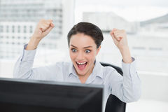 Excited businesswoman looks at the computer screen in office Stock Image