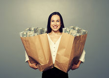 Excited businesswoman with money Royalty Free Stock Image
