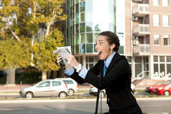 Excited businesswoman with newspaper Stock Images