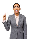 Excited Businesswoman Pointing Upwards Royalty Free Stock Image