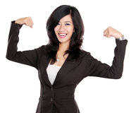 Excited businesswoman raised her hands showing strong concept Stock Image