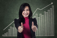 Excited businesswoman showing thumbs up 1 Royalty Free Stock Image