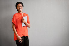 Excited businesswoman smiling at camera while holding a digital tablet Royalty Free Stock Photo