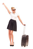 Excited Businesswoman with suitcase. Royalty Free Stock Photo
