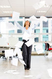 Excited businesswoman throwing papers Stock Photography