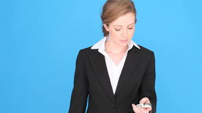 Excited Businesswoman Using Mobile Phone Royalty Free Stock Photos