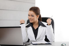 Excited businesswoman. Excited young businesswoman in the office stock image