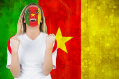 Excited cameroon fan in face paint cheering Stock Photo