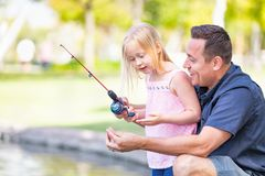 Free Excited Caucasian Father And Daughter Having Fun Fishing At The La Stock Photo - 116033960