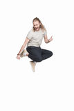 Excited caucasian man jumping in black jeans. Isolated on white Stock Image