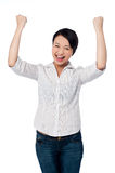 Excited charming girl with clenched fists Stock Photo