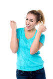Excited charming girl with clenched fists Stock Images
