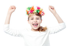 Excited charming kid raising her arms up Stock Image