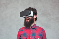 Excited cheerful bearded man having VR experience Stock Images