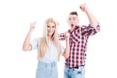 Excited and cheerful couple raising hands up Royalty Free Stock Photos