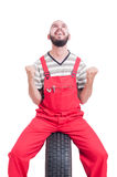 Excited and cheerful mechanic making winner and victorious gestu Royalty Free Stock Photos