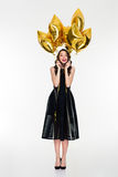 Excited cheerful woman with bright golden balloons celebrate her birthday Stock Photography