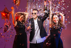 Excited cheerful young friends dancing and having party Stock Photography