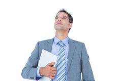 Excited cheering businessman holding his laptop Stock Photo