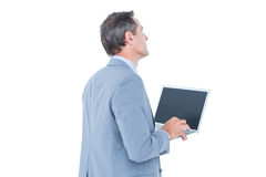 Excited cheering businessman sitting using his laptop Royalty Free Stock Photos