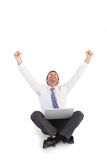 Excited cheering businessman sitting using his laptop Stock Photos