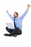 Excited cheering businessman sitting using his laptop Royalty Free Stock Photography