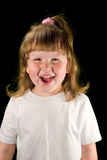Excited child. Excited laughing child wearing white t-shirt stock images