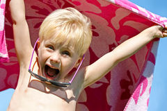 Excited Child in Beach Towel on Summer Day Royalty Free Stock Photography