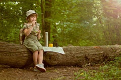 Excited child on camping trip in green forest royalty free stock photos