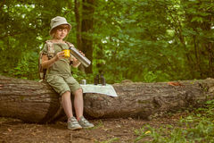 Excited child on camping trip in green forest royalty free stock photo