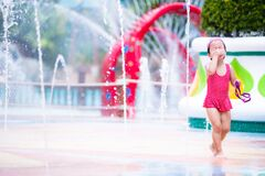 Free Excited Child Girl Having Fun Between Water Splashes In Fountain Courtyard. Summertime In City. In Hot Day. Kid Aged 3-4 Years Old Royalty Free Stock Photos - 205401378
