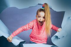 Free Excited Child Girl Making Hole In Paper. Child Girl Looking Out Of A Paper Hole. Banner. Happy Girl. Curious Kid Looks Royalty Free Stock Image - 179964776