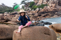 Excited child with a hat gesturing, enjoying fun outdoors activity Royalty Free Stock Images