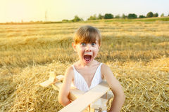 Excited child. Excited little girl in the wheat field Stock Images