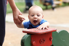 Excited child at playground Stock Photography