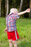 Excited child playing outdoor raised his head up Royalty Free Stock Images
