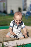 Excited child in sandbox Royalty Free Stock Image