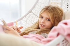 Excited child writing dreams in day book Stock Photography