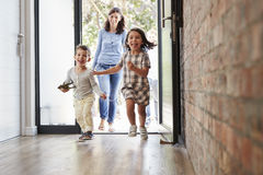 Excited Children Arriving Home With Parents royalty free stock image