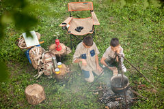 Excited children on a camping trip Stock Photos
