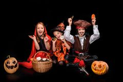 Devil, witch and pirate with sweets royalty free stock photos