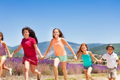Excited children running together in Provence Stock Photos