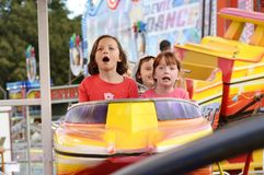 Excited Children Screaming On Carnival Roller Coaster Ride Royalty Free Stock Photo