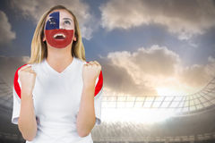 Excited chile fan in face paint cheering Stock Photo
