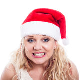 Excited Christmas woman face. Excited woman in Christmas hat, isolated on white background Royalty Free Stock Photography