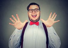 Excited chubby man posing happily. Young obese man looking super excited while posing at camera having great news Royalty Free Stock Photos