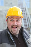 Excited chubby manual worker Royalty Free Stock Images