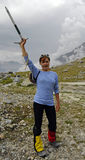 Excited climber. Climber girl in striped blue shirt is excited about upcoming hike stock photo