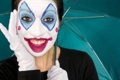Excited Female Circus Clown Gloves Umbrella TEal. Really Excited Clown with Teal Umbrella Stock Images