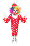 Excited clown giving thumbs up. Isolated on white background Stock Photo